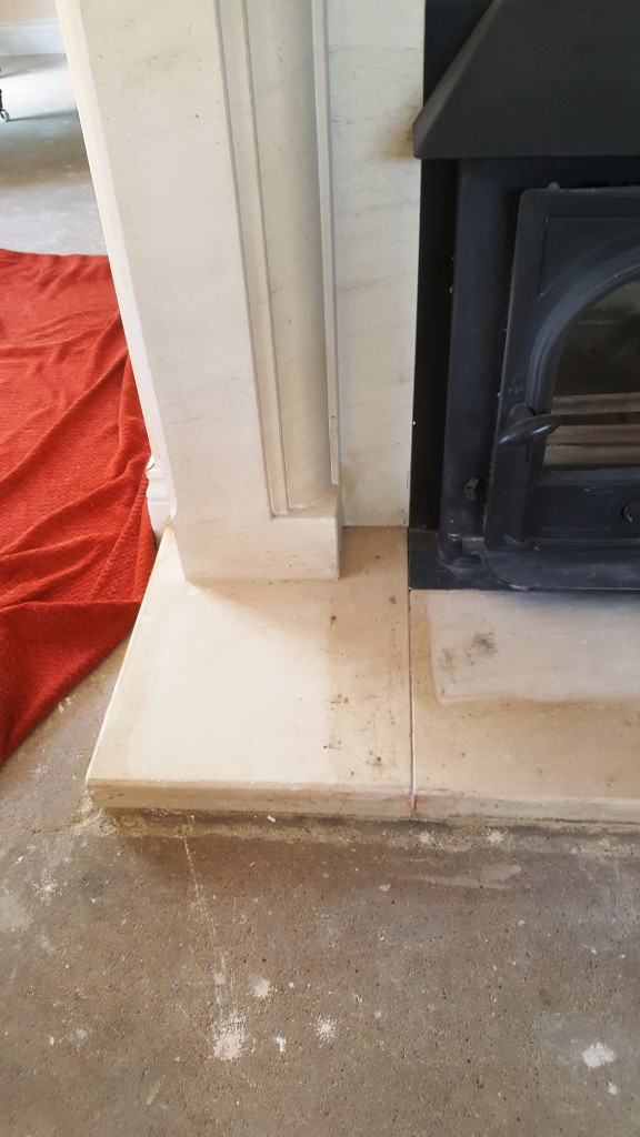 Limestone Fireplace Before Flood Stain Removal Chelmsford