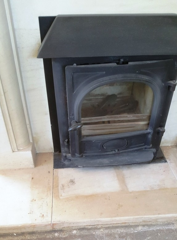 Limestone Fireplace Showing Flood Staining Chelmsford